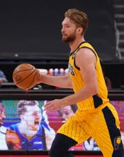 May 16, 2021; Tampa, Florida, USA; Indiana Pacers forward Domantas Sabonis (11) dribbles the ball up the court against the Toronto Raptors during the second half at Amalie Arena. Mandatory Credit: Jasen Vinlove-USA TODAY Sports.