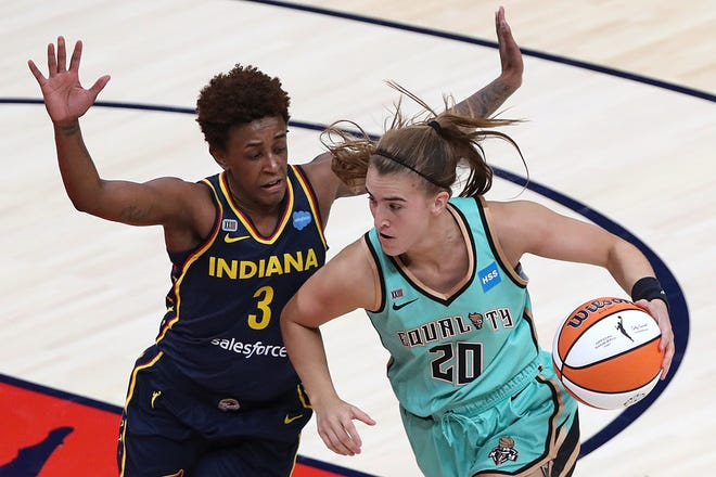 Indiana Fever guard Danielle Robinson (3) guards New York Liberty guard Sabrina Ionescu (20) during the third quarter of the home opener Sunday, May 16, 2021, at Bankers Life Fieldhouse in Indianapolis. The Fever lost, 73-65.