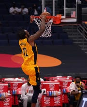 May 16, 2021; Tampa, Florida, USA; Indiana Pacers forward Oshae Brissett (12) dunks the ball against the Toronto Raptors during the first half at Amalie Arena. Mandatory Credit: Jasen Vinlove-USA TODAY Sports