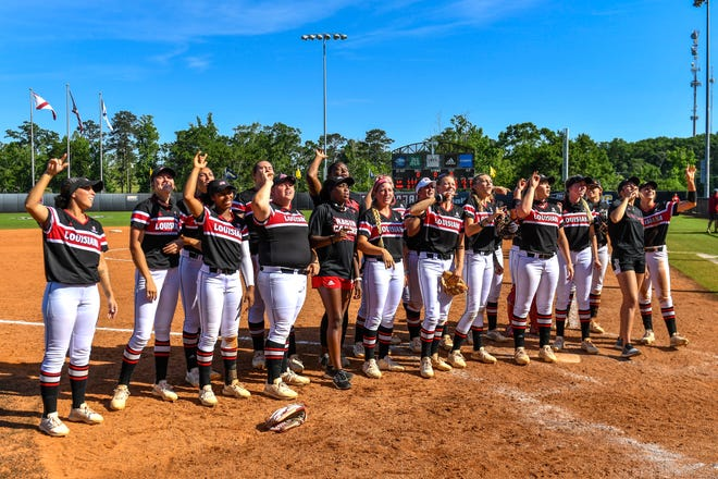 The No. 14 Ragin' Cajuns celebrate after their Sun Belt Conference Softball Tournament championship game win over South Alabama on Saturday in Troy, Alabama.