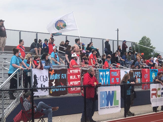 Fans watch the Lansing Common Football match on May 15, 2021, at Eastern High School.