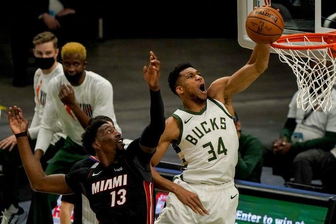 Giannis Antetokounmpo misses a dunk after beating Miami's Bam Adebayo to the basket.