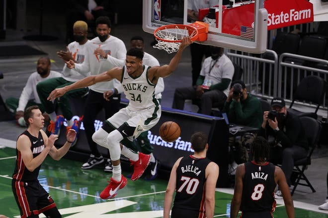MILWAUKEE, WISCONSIN - MAY 15: Giannis Antetokounmpo #34 of the Milwaukee Bucks reacts to a dunk against the Miami Heat during the first half of a game at Fiserv Forum on May 15, 2021 in Milwaukee, Wisconsin. NOTE TO USER: User expressly acknowledges and agrees that, by downloading and or using this photograph, User is consenting to the terms and conditions of the Getty Images License Agreement. (Photo by Stacy Revere/Getty Images)