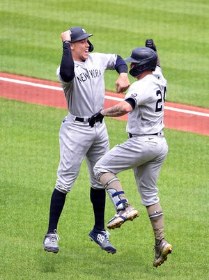May 16, 2021; Baltimore, Maryland, USA; New York Yankees catcher Gary Sanchez (24) is congratulated by outfielder Aaron Judge (99) after hitting a home run in the first inning against the Baltimore Orioles at Oriole Park at Camden Yards. Mandatory Credit: Evan Habeeb-USA TODAY Sports