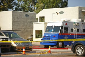 Police tape surrounds an apartment complex after two children were killed on May 15, 2021, in Tempe.