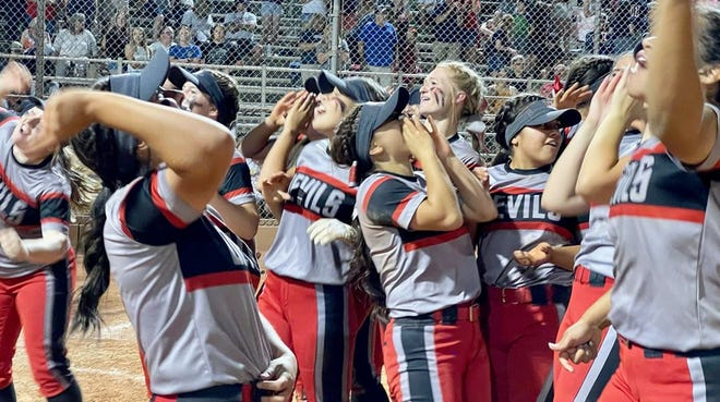 The River Valley high school softball team celebrates after winning the 2A state championship at Rose Mofford Sports Complex in Phoenix.