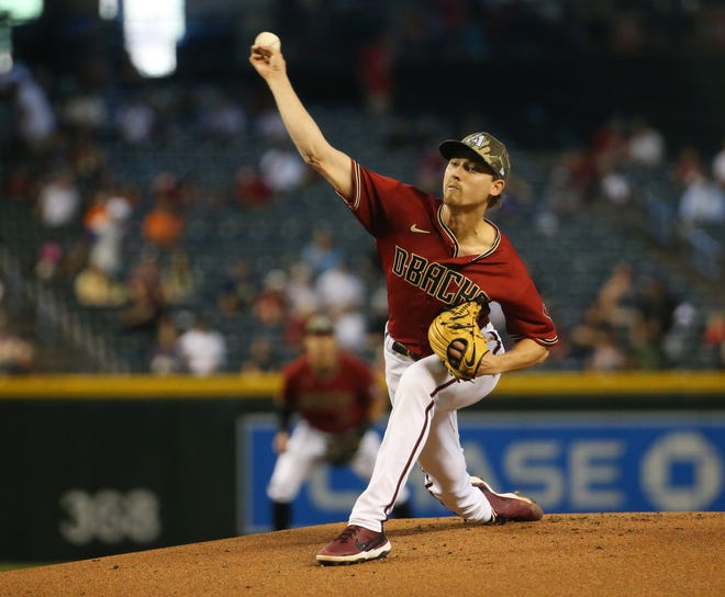 Arizona Diamondbacks starting pitcher Luke Weaver (24) throws against the Washington Nationals during the first inning at Chase Field May 16, 2021.