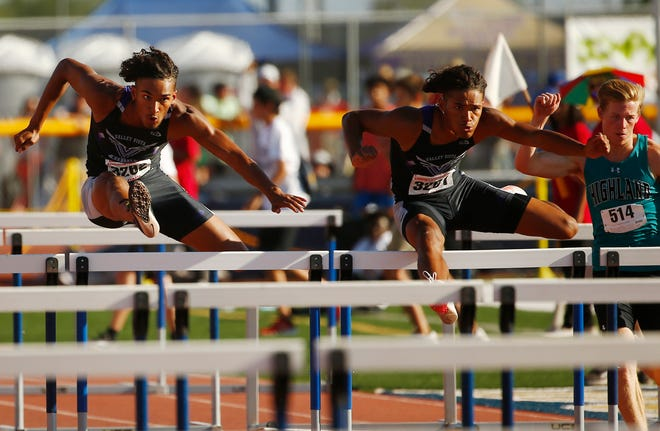 May 15, 2021; Phoenix, Arizona, USA; Tyson Givens (left) and his brother Trenton Givens compete in the Boys 110 Meter Hurdles during Track and Field State Championships at Desert Vista High School. Patrick Breen-Arizona Republic