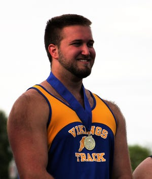 Northern Lebanon's Dylan Lambrecht was all smiles after winning the shot put and discus titles in dominant fashion Saturday at the Lancaster-Lebanon Track and Field Championships.