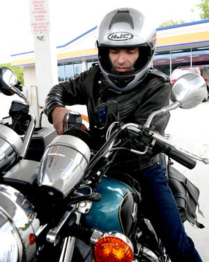 Michel Rosman of Reisterstown, Md., fills the tank on his Kawasaki motorcycle while taking a recreational ride Sunday, May 16, 2021. He stopped at the Tom's at Shrewsbury Exit 4 on Interstate 83. Bill Kalina photo
