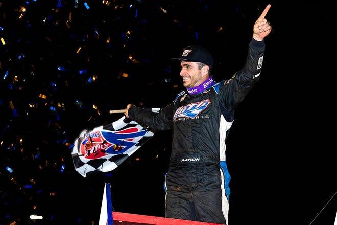 Aaron Reutzel celebrates his Williams Grove Speedway victory on Saturday night.