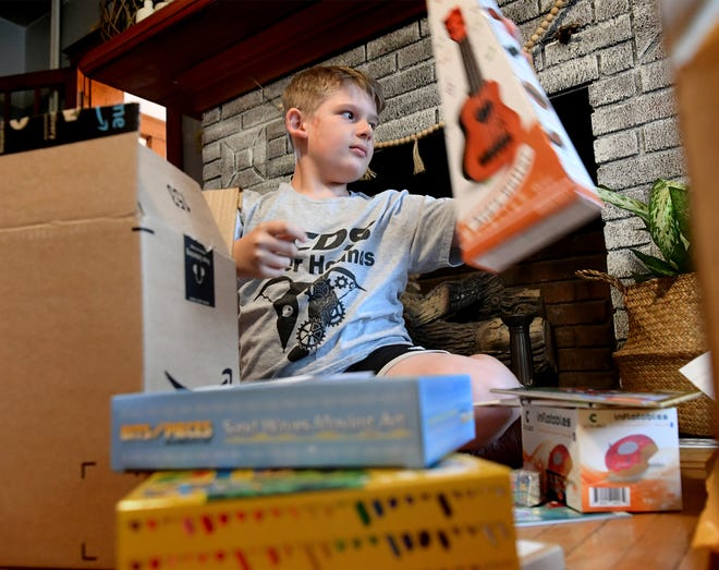 Jameson Shanabrough, 10, opens donations of toys at his Spring Garden Township home Sunday, May 16, 2021. Jameson has organized a toy drive to benefit children at Philadelphia's St. Christopher's Hospital for Children. The York Country Day School student is currently about 150 items short of the 1600-item goal he's set for the drive. Bill Kalina photo