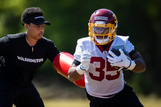 Washington Football Team running back Jaret Patterson (35) participates in a drill with assistant running backs coach Jennifer King during rookie minicamp at Inova Sports Performance Center on May 15.