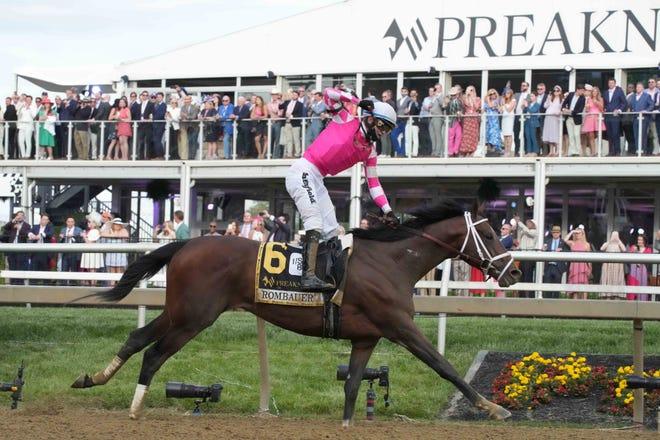 Jockey Flavien Prat celebrates as Rombauer wins the 146th Preakness Stakes.