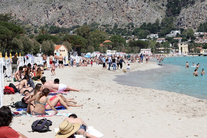 A view of the beach of Mondello, Sicily, crowded with sunbathers after the slowdown of the COVID virus allowed the reopening of beaches in Sicily.