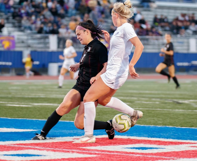 Dripping Springs defender Rylie Flores, left, battles for the ball during a playoff win over Liberty Hill last month. Flores was among the Austin-area soccer players who earned all-state recognition from the Texas Association of Soccer Coaches.