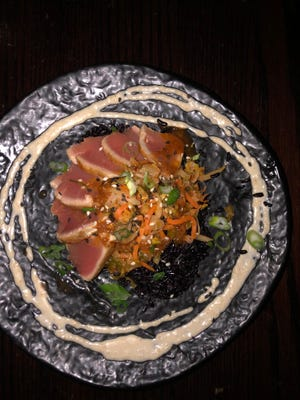 The ahi tuna appetizer at 111 Bistro is paired with Napa cabbage kimchi and Chinese black rice.