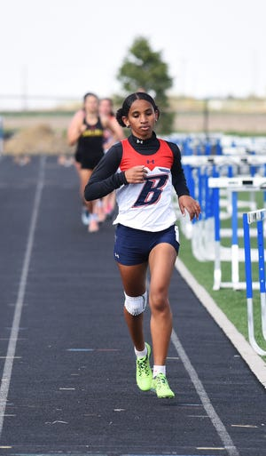 Shewaye Johnson (pictured) and teammate Paityn Noe went 1-2 in Class 3A at the state cross country meet in the fall and they plan on doing the same thing in the 3A girls' 3,000 at the state co-ed track meet this Thursday at Drake Stadium in Des Moines.