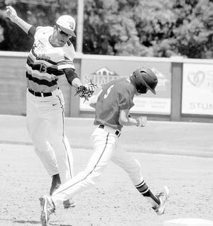 Bartlesville American Legion player Harald Borg, right, avoids a tag while reaching the bag during summer play a few years ago.