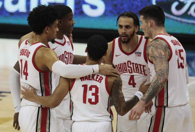 The Ohio State Buckeyes huddle up before a free throw during the first half of a NCAA Division I men's basketball game between the Ohio State Buckeyes and the Illinois State Redbirds on Wednesday, Nov. 25, 2020 at Value City Arena in Columbus, Ohio.