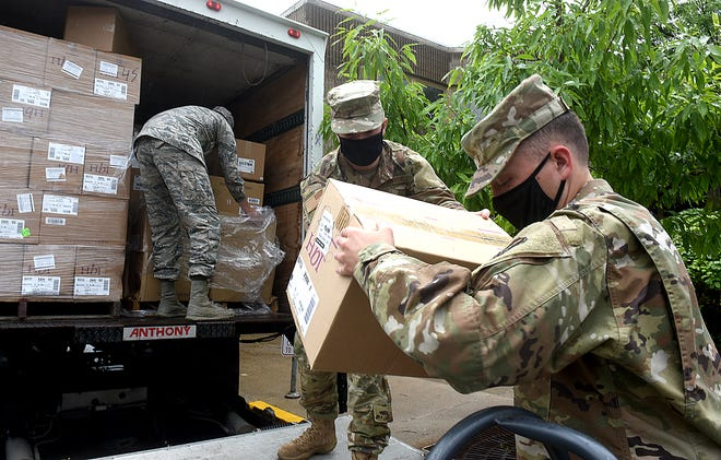 University of Missouri Air Force ROTC Detachment 440 Airmen from left, Cadet Tech Clayton Liberman, Second Lt. Tanner Bahora and Cadet 3rd Class Spencer Anderson unload boxes of face masks Monday at the U.S. Exercise Tiger Foundation.