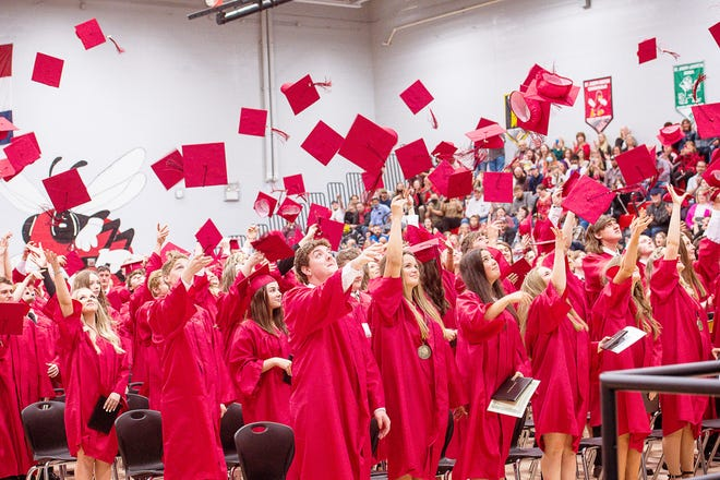 Their diplomas in hand, signaling their official graduation from Chillicothe High School as members of the Class of 2021, class members engage in the traditional upward fling of their mortarboards just prior to the conclusion of Sunday evening's commencement exercises at the CHS gym.