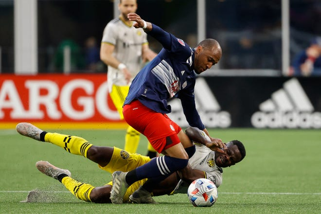 New England forward Teal Bunbury knocks down Crew defender Waylon Francis during Sunday's 1-0 Revolution victory. The Crew's MLS record dropped to 1-2-2.
