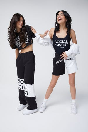 Social influencers Charli D'Amelio, left, and Dixie D'Amelio have partnered with Abercrombie & Fitch to promote the retailer's Social Tourist brand by Hollister.