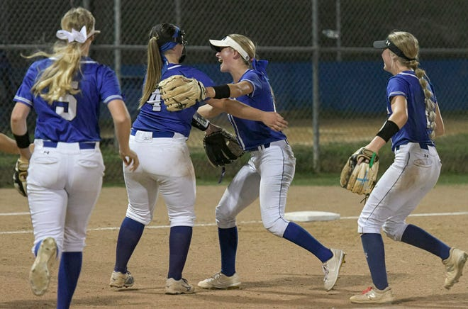 Players from the Mount Dora Christian Academy softball team celebrate after beating Deltona Trinity Christian 4-0 on May in a Class 2A-Region 2 quarterfinal game at Martha Johnson Field in Mount Dora. The Bulldogs play Jacksonville Trinity Christian Tuesday in a Class 2A state semifinal game in Clermont. w[PAUL RYAN / CORRESPONDENT]