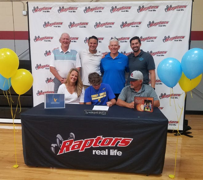 Real Life Christian Academy baseball player Noah Clymer (seated, center) signs a national letter of intent with Embry-Riddle Aeronautical University during a recent signing ceremony. [COURTESY / DEBI LAWSON]