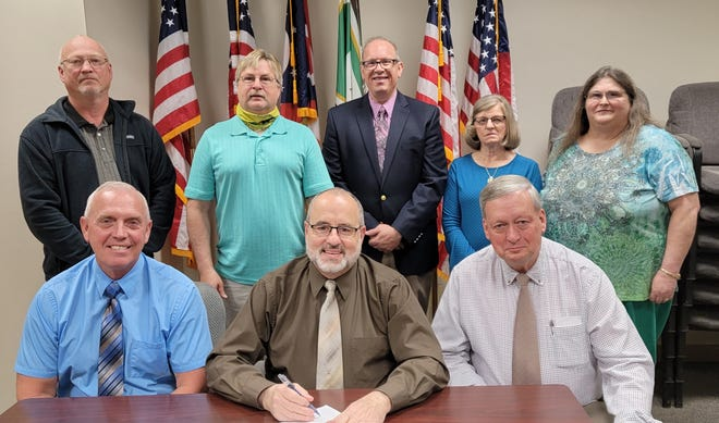 Guernsey County commissioners on Monday signed a proclamation supporting the GMN Tri-County CAC during Community Action Month. Pictured front row from left, Commissioners Jack Marlin, Dave Wilson, Skip Gardner, back row, Randy Mercer, GMN Housing director, Gary Ricer, CEO, Doug Dye, CFO, Judy Spires, HEAP/CSBG director, and Bonnie Carpenter, Head Start/Early Head Start director.