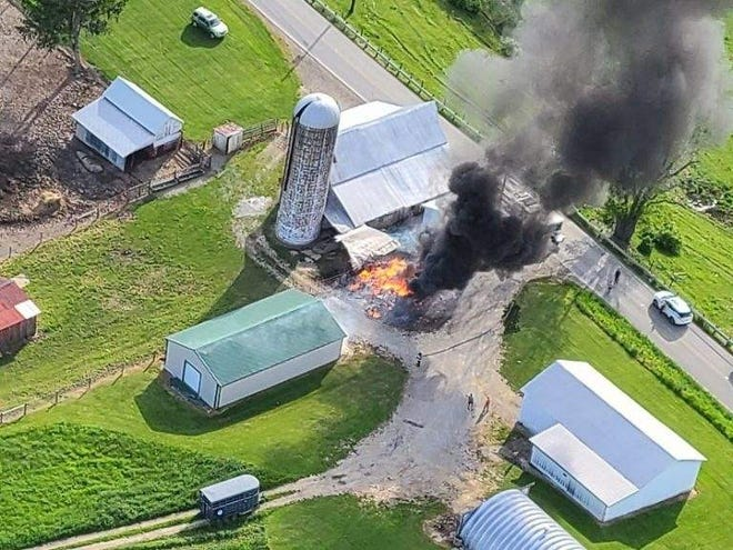 Drone footage captured Old Washington firefighters starting to attack a fire that ignited while a lawn mower was being refueled at a Larrick Ridge Road farm Saturday. A 13-year-old boy suffered burns to his torso and neck. He was transported by private vehicle to Southeastern Med for treatment.