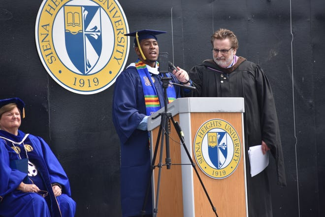 Kendrick Green, a 2021 graduate of Siena Heights University, speaks during the university's spring commencement May 16 at Michigan International Speedway. Green was the student speaker for the College of Arts and Sciences.