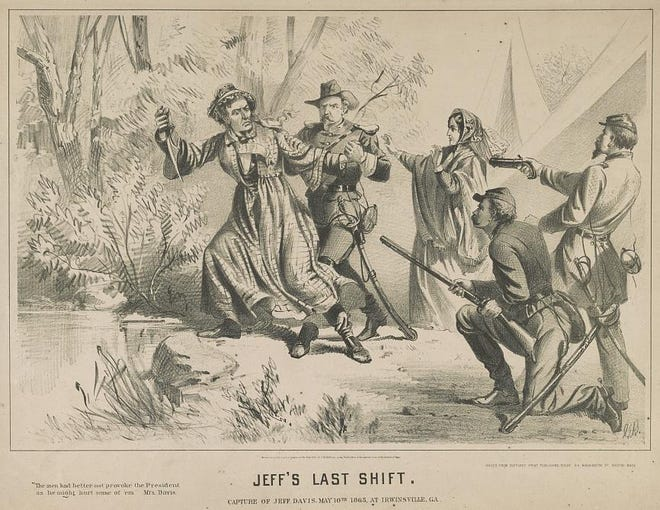 Confederate President Jefferson Davis is captured by members of the 4th Michigan Cavalry, including Cpl. William H. Crittenden of Lenawee County. Although not all historians agree, many eyewitness accounts tell of Davis being disguised as a woman at the time of his arrest. Many Northern newspapers published pictures similar to this one.