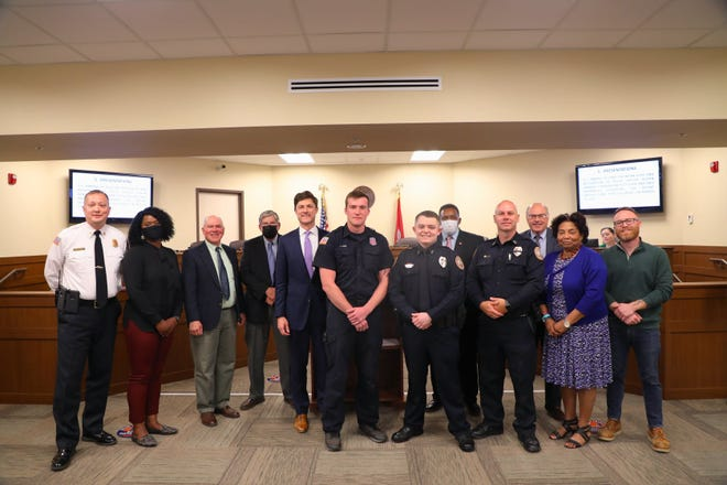Columbia Police officer Austin Sanders and firefighter Kitt Cook, along with paramedics, are recognized for their response to a woman giving birth at a Walgreens on March 11.