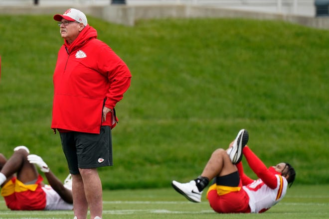 Kansas City Chiefs head coach Andy Reid watches as his players warm up for rookie minicamp.