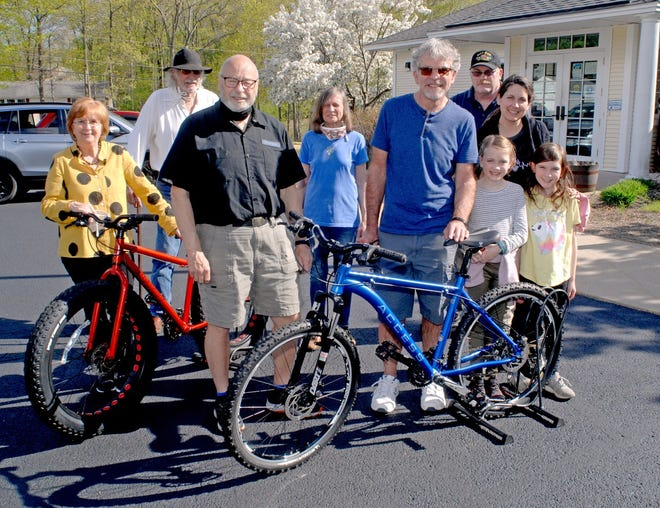 Bob DeLong of Brunswick, Maine, center right, is the winner of the Berwick Library Association bicycle raffle. With DeLong are, from the left, Berwick Public Library Director Sharon Kelly, library volunteer Ron Tuveson, Berwick Library Association Board of Directors members Jerry Morin, Paula Lepore, Michael Schroeder, Leighanne Wurtz and her children Layla and Brielle (DeLong's grandchildren).