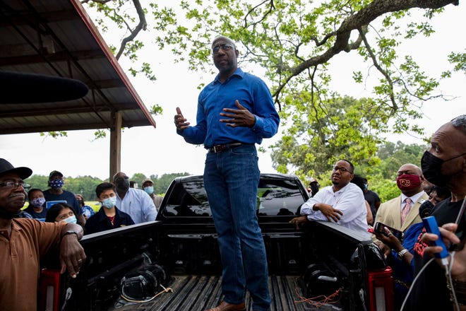U.S. Sen. Rev. Raphael Warnock speaks with Black farmers in Byromville, Ga., on May 4. Warnock addressed targeted federal relief in the American Rescue Plan for farmers of color and vowed to tackle the history of discriminatory practices by the United States Department of Agriculture.