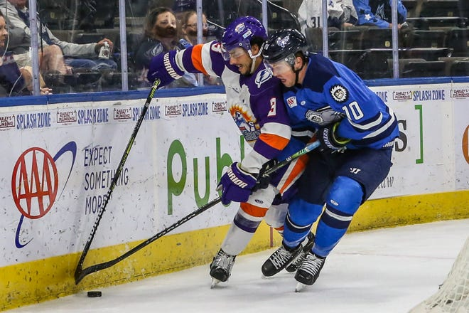 Solar Bears defenseman Luke McInnis (3) and Icemen forward Christopher Brown (10) vie for the puck during an April 15 game.