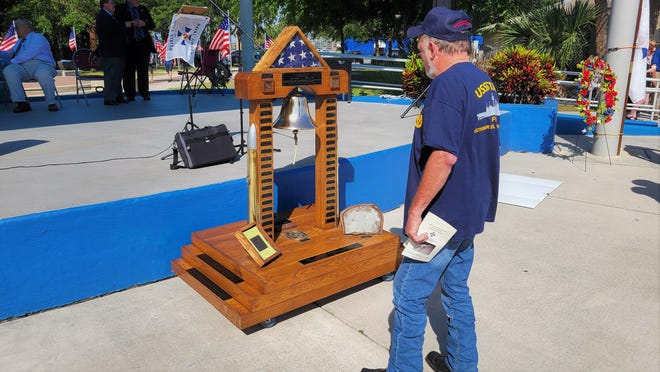 USS Stark crewman John Prebatte shares a quiet moment with the memorial to his crewmates who died when the Mayport-based ship was hit by Iraqi missiles on May 17, 1987.
