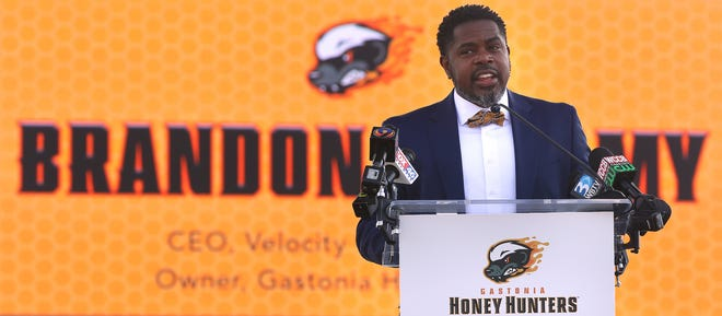 Honey Hunters owner Brandon Bellamy speaks during the Honey Hunters press conference May 17 at CaroMont Health Park.