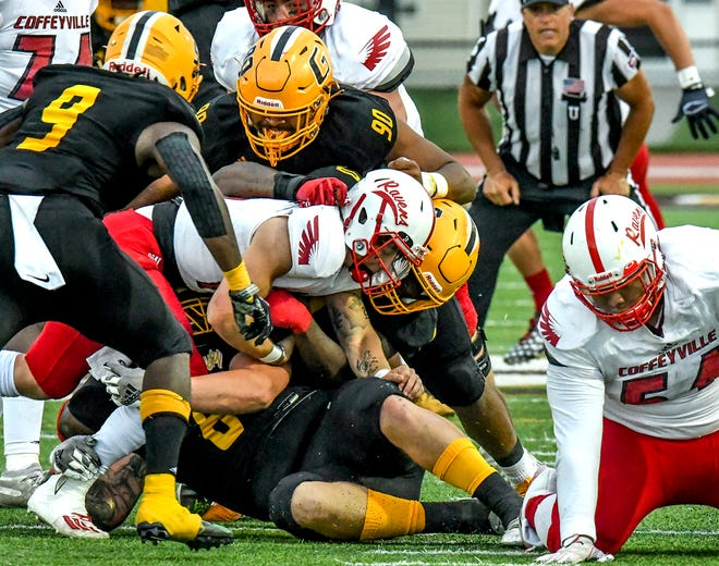 Garden City Community College defenders break through the Coffeyville offensive line to sack Red Raven quarterback Nick Arvay Saturday at Broncbuster Stadium.  Shown on the play for GCCC include Darius Johnson (8), Raymond Cutts (0), Eilye-Oshaye Hill (90) and Kevin Abrams-Verwayne.