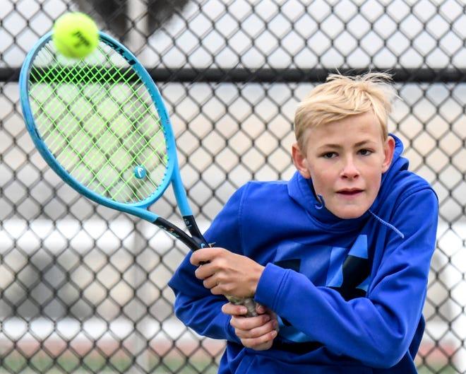 Garden City High School's Logan Morren hits a backhand shot crosscourt during a singles match in the GCHS boys tennis invitational earlier this season.