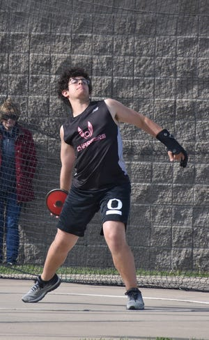 Orion's Brody Straw leans back as he prepares to throw the discus on Tuesday, May 11, when the Chargers hosted the Morrison Mustangs.