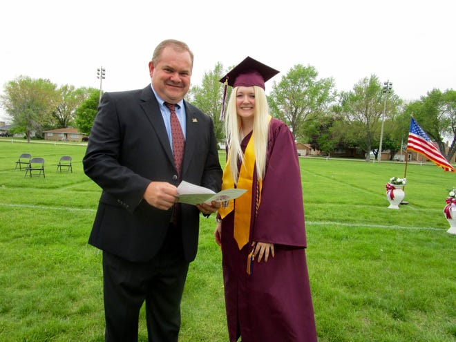 Scott Wiesbrook, a member of the Annawan Class of 1992, was guest speaker at graduation exercises held Sunday in Annawan. Prior to the ceremony, he visited with his niece Sophia Wiesbrook, a member of the Annawan Class of 2021. The speaker graduated form the University of Illinois and is a Wetland Soil Scientist and Project Leader for Soils, and Soil Judging Coach for the University of Illinois and Black Hawk College, East Campus
