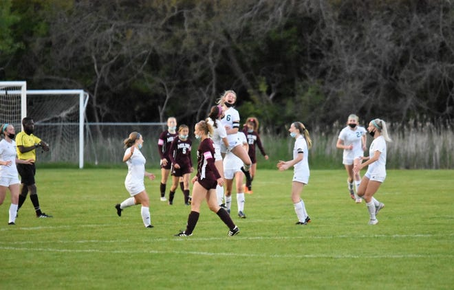 The Lady Leafs celebrate after their 1-0 victory over Moline in overtime. In the photo are Taylor DeSplinter, No. 6; Mikala Warner, No. 29; Chloe Adams, No. 2; and Elizabeth Maciejewski, No. 18.