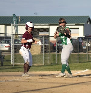 Geneseo's Taylor Zvonik holds a runner at third in the recent softball doubleheader with Moline. The two-game challenge ended with each team scoring a victory.