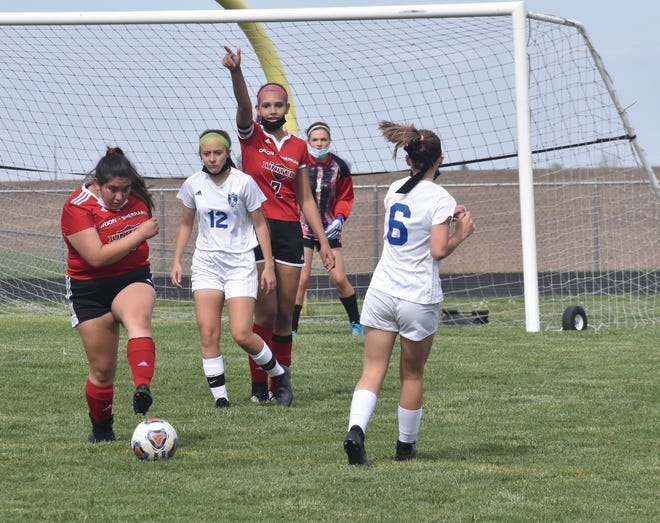 After turning away a Bartonville Limestone attack, the Orion-Sherrard players launch a counterattack on Friday, May 14, at Charger Field. From front to back are Samantha Avila, Hailey James (7) and keeper Jennie Abbott