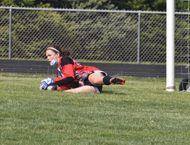 Orion-Sherrard's Jennie Abbott dives for a save during the match with Bartonville Limestone on Friday, May 14, at Charger Field