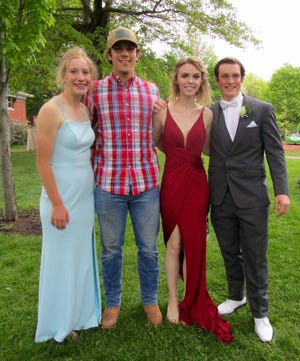 Lauren Johnsen, left; Dominic DeBoef, Audrey Lamb and Drayton DeBoef have their photo taken in City Park before Geneseo's Prom.